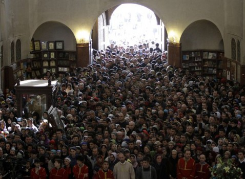 People attend a Good Friday mass at Holy Trinity cathedral in Tbilisi